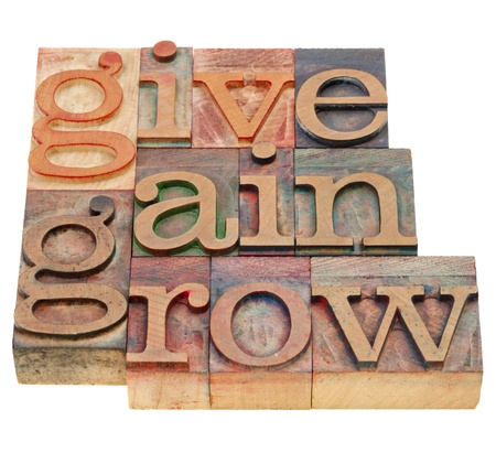 gain: give, gain and grow -personal development concept - isolated word abstract in vintage wood letterpress printing blocks