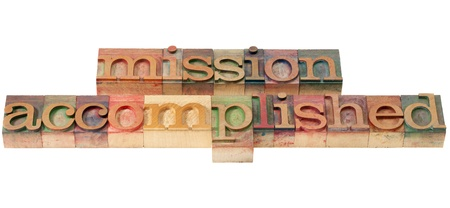 mission accomplished - isolated text in vintage wood letterpress prinitng blocks Stock Photo - 10412960