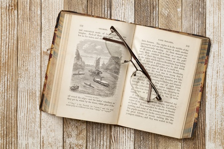 copyrights: antique illustrated book with reading glasses on grunge white painted wood table, Rob Roy in the Baltic by J. MacGregor published in 1867, out of copyrights Stock Photo