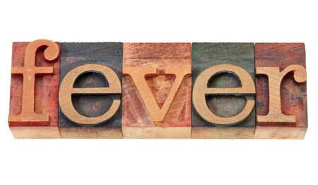 fever  - isolated word in vintage wood letterpress printing blocks Stock Photo - 10493241