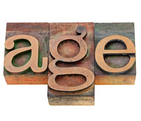 age - isolated word in vintage wood letterpress printing blocks stained by color inks Stock Photo - 10493245