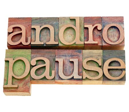 andropause: andropause - male menopause - isolated word in vintage wood letterpress printing blocks stained by color inks Stock Photo