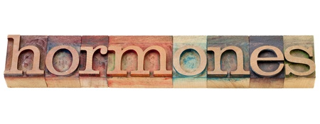 hormone: hormones -  health concept - isolated word in vintage wood letterpress printing blocks stained by color inks Stock Photo