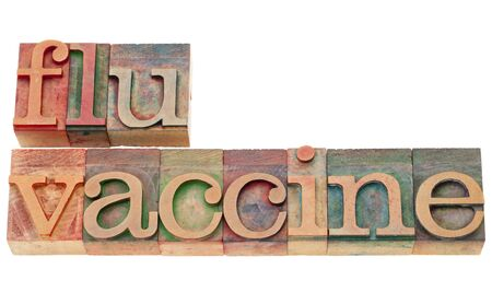 flu vaccine - isolated text in vintage wood letterpress type Imagens