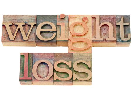 letterpress: weight loss - isolated words in vintage wood letterpress type