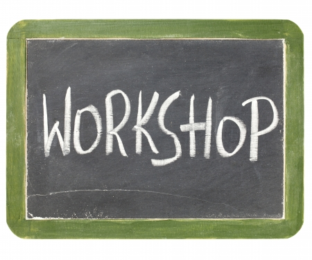 workshop seminar: workshop word in white chalk handwriting on a vintage slate blackboard, isolated on white Stock Photo