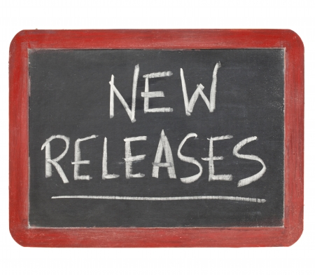 news update: new releases  text  in white chalk handwriting on a vintage slate blackboard, isolated on white