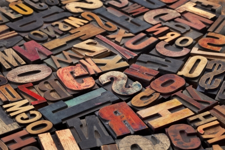 letterpress letters: antique wood letterpress printing blocks with color ink patina, random collection of different size and style