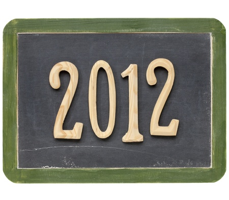 year of 2012  - wooden numbers on a small slate blackboard, isolated on white Stock Photo - 10594231