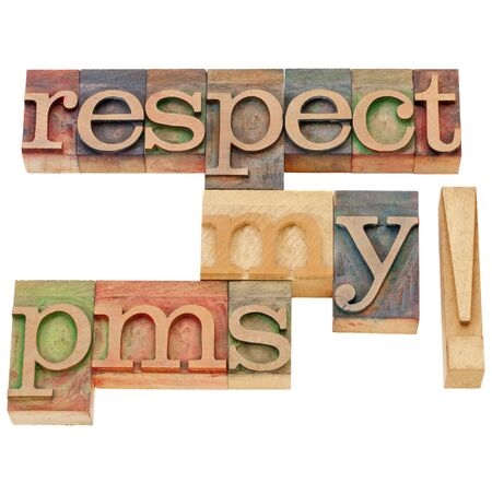 premenstrual syndrome: respect my pms (premenstrual syndrome)  - isolated text in vintage wood letterpress printing blocks Stock Photo