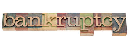 bankruptcy  - isolated text  in vintage wood letterpress type Imagens