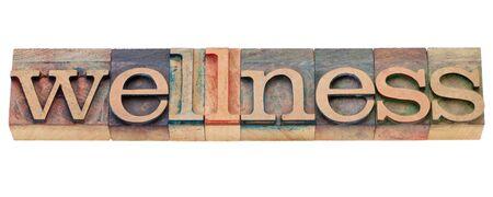 letterpress  type: wellness - isolated word in vintage wood letterpress type Stock Photo