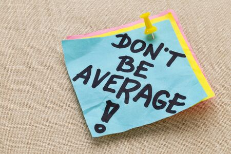 note of exclamation: Motivational concept - Do not be average exclamation  - handwriting on a blue sticky note against canvas board