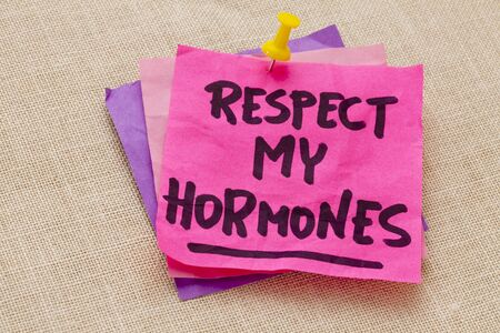 note of exclamation: respect my hormones -humourous warning  - handwriting on a purple sticky note against canvas board