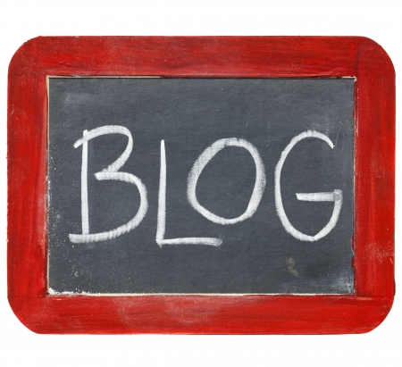 blogging: blog sign - white chalk handwriting on old slate blackboard with grunge red wood frame Stock Photo