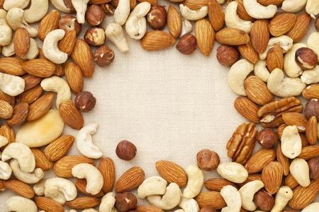 nut mix (walnut, almond, brazilian, hazelnut, cashew) on canvas with a copy space Stock fotó