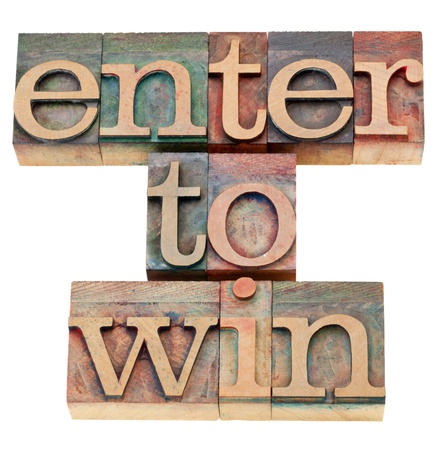 contest: enter to win - isolated text in vintage wood letterpress printing blocks Stock Photo