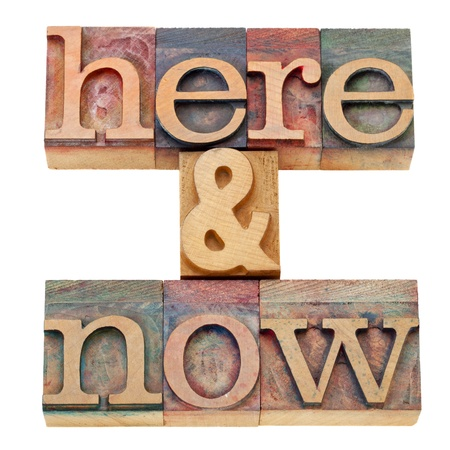 here and now - isolated text in vintage wood letterpress printing blocks Stock Photo - 10743759