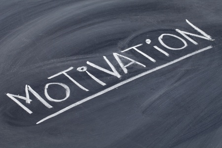 motivation word in white chalk handwriting on blackboard Stock Photo - 10819265