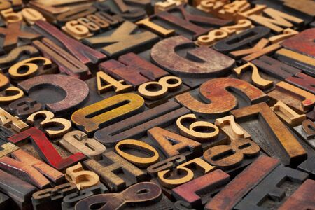 random letters and numbers in antique wood letterpress printing blocks of various size and style Stock Photo - 10819263