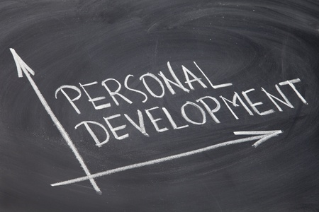 self development: personal development concept - white chalk drawing on a blackboard Stock Photo