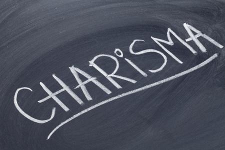 charisma: charisma word in white chalk handwriting on blackboard