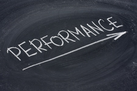 performance word in white chalk handwriting on blackboard