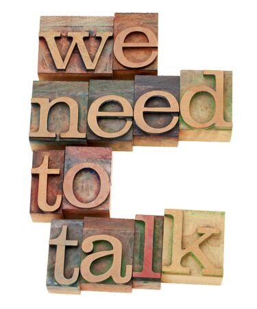 we need to talk request - isolated text in vintage wood letterpress printing blocks photo