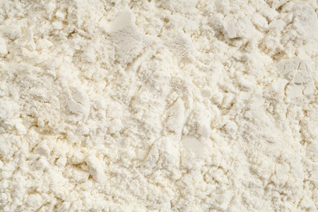 background of white  whey protein isolate powder photo