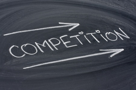competition, word in white chalk handwriting on blackboard