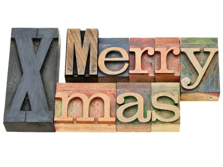 Merry Xmas greetings - isolated text in vintage wooden letterpress printing blocks photo