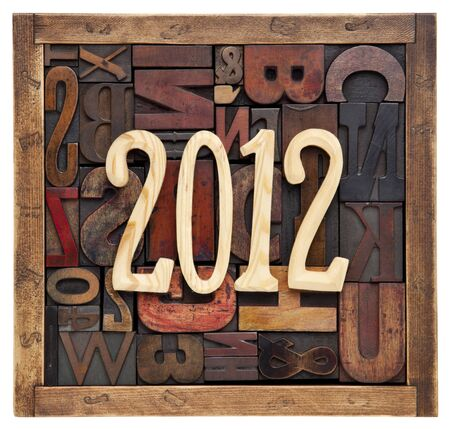year 2012 in unfinished wood letters over a box of antique letterpress printing blocks Stock Photo
