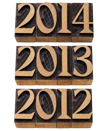 incoming years 2012, 2013, 2014 - isolated numbers in vintage wood printing blocks photo