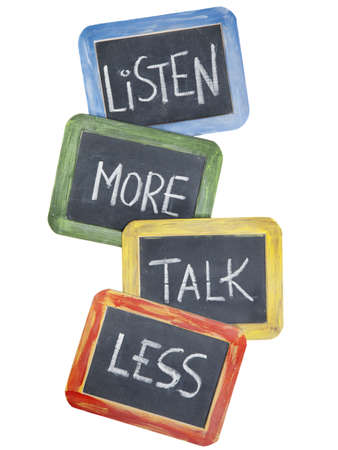 recommendation: listen more, talk less - communication concept or advice - white chalk handwriting on small slate blackboards, isolated on white