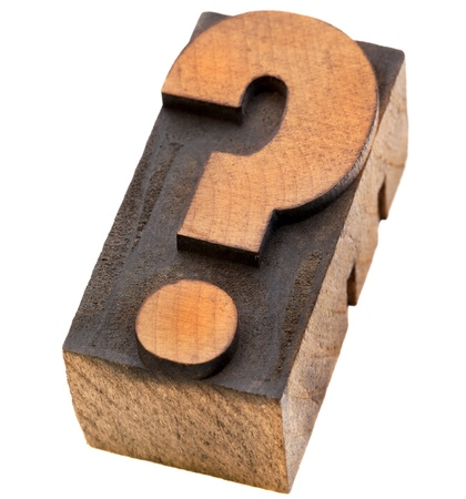 question mark - a vintage wood letterpress type block, stained by black ink, isoalated on white Stock Photo - 11179844