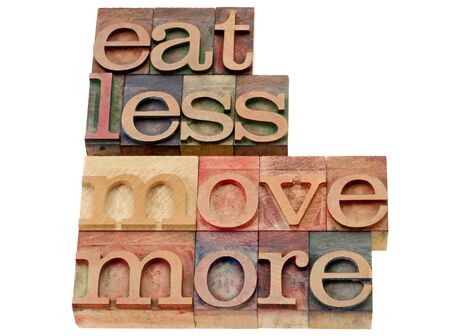 healthy living: eat less, move more - words of wisdom for healthy living - isolated text in vintage wood letterpress printing blocks Stock Photo