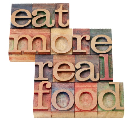 eat more real food - healthy lifestyle concept - isolated text in vintage wood letterpress printing blocks Stock Photo - 11279637