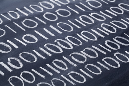 binary code abstract - rows of zero and one numbers in white chalk handwriting on blackboard Stock Photo - 11279642