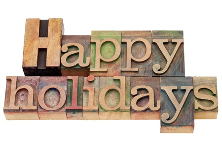 happy holidays - isolated text in vintage wood letterpress printing blocks Stock Photo - 11279645