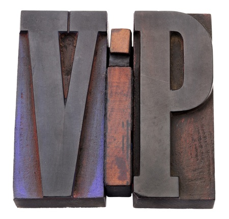 notable: VIP (very important person)  acronym - isolated vintage wood letterpess printing blocks stained by color inks