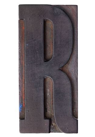 letter r: letter R - isolated antique wood letterpress printing  block stained by color inks