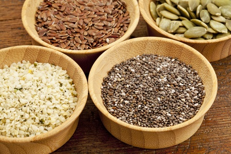 chia, hemp, flax and pumpkin - healthy seeds in small wooden bowls Stok Fotoğraf