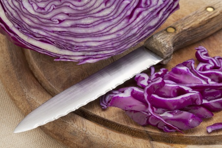 red cabbage and knife on a wooden cutting board Stock Photo - 11279655