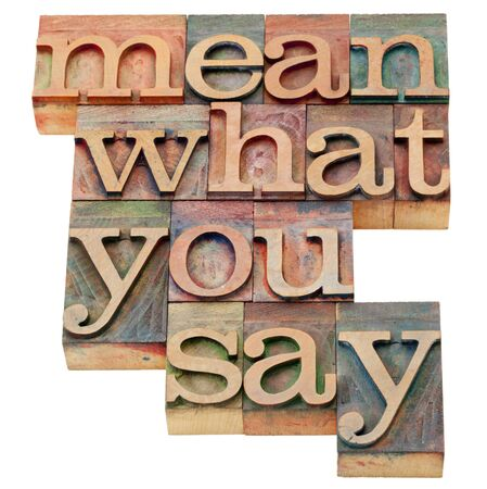 printing block block: mean what to say - advice in isolated vintage wood letterpress printing blocks Stock Photo