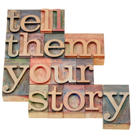 tell them your story - advice in isolated vintage wood letterpress printing blocks Stock Photo