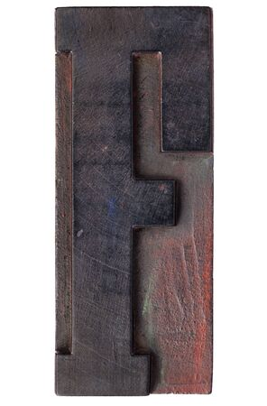 printing block: letter F - isolated antique wood letterpress printing  block stained by color inks
