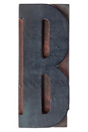 letter B - isolated antique wood letterpress printing  block stained by color inks Stock Photo - 11474248