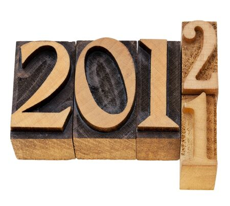 changing years 2011 and 2012 - isolated numbered in vintage wood letterpress printing blocks Stock Photo - 11577571