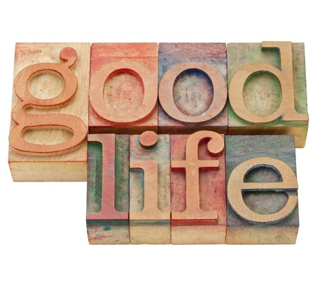 good quality: good life - isolated text in vintage wood letterpress printing blocks Stock Photo