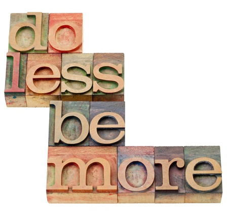 meaningful: do less be more motivation - isolated text in vintage wood letterpress printing blocks